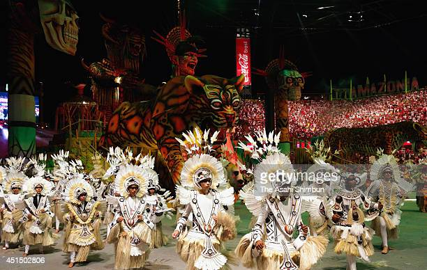 Participants perform during the Boi Bumba festival on June 27 2014 in Parintins Brazil The festival is thought to be the beiggest outdoor opera in...
