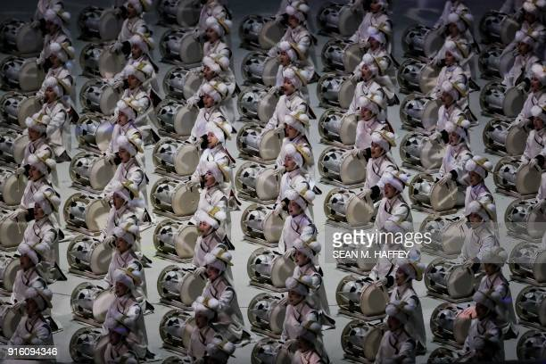 TOPSHOT Participants perform during the opening ceremony of the Pyeongchang 2018 Winter Olympic Games at the Pyeongchang Stadium on February 9 2018 /...
