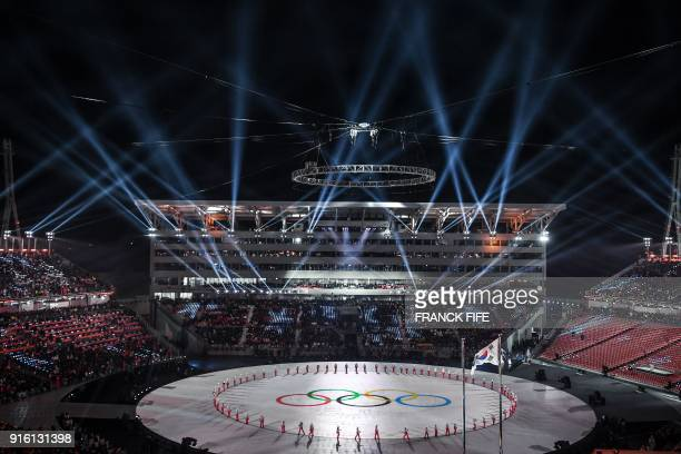Participants perform during the opening ceremony of the Pyeongchang 2018 Winter Olympic Games at the Pyeongchang Stadium on February 9 2018 / AFP...