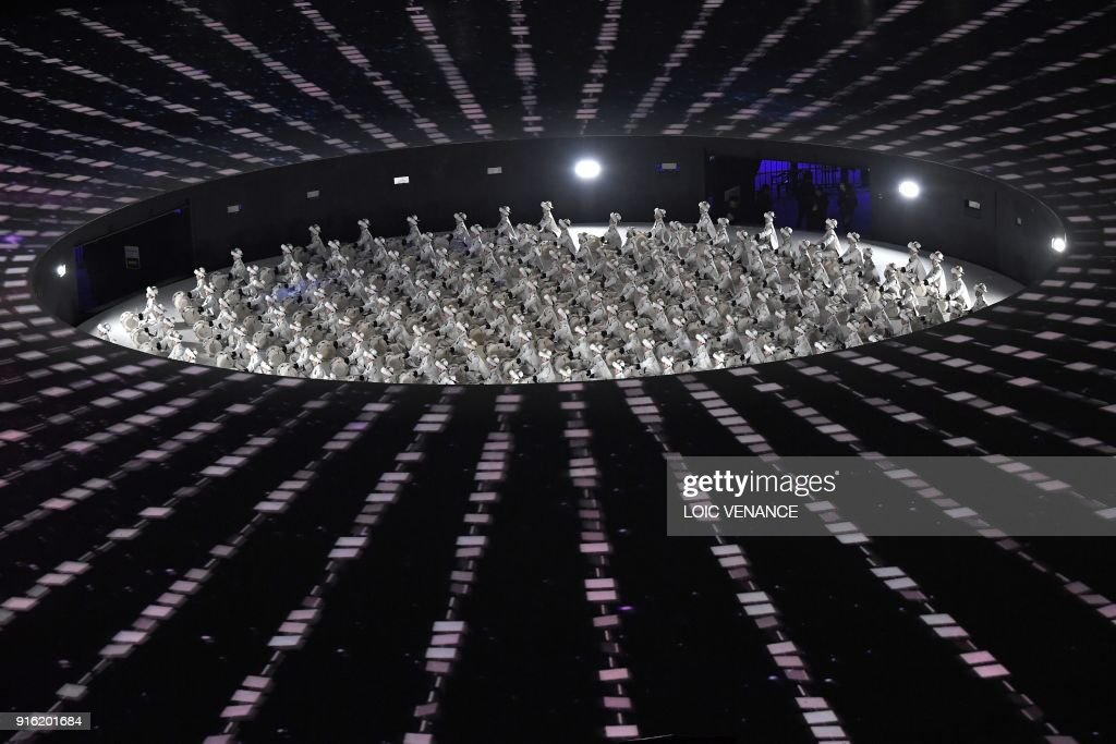 TOPSHOT - Participants perform during the opening ceremony of the Pyeongchang 2018 Winter Olympic Games at the Pyeongchang Stadium on February 9, 2018. /
