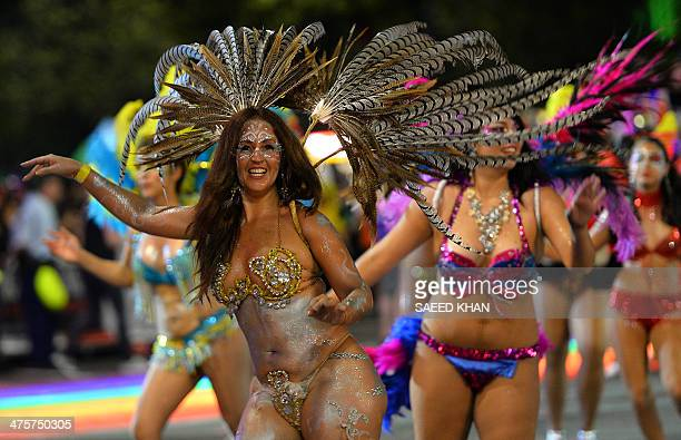 Participants perform during the Sydney's annual gay and lesbian Mardi Gras night parade on March 1 2013 Some 10000 revellers on 144 individual floats...