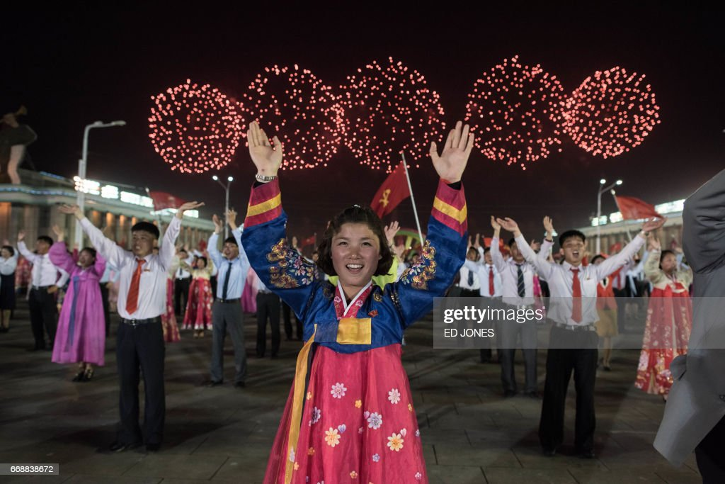 Participants perform in a mass dance event on Kim Il-Sung square marking the 105th anniversary of the birth of late North Korean leader Kim Il-Sung, in Pyongyang on April 15, 2017. /