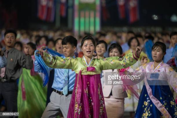 Participants perform in a mass dance event on Kim IlSung square marking the 105th anniversary of the birth of late North Korean leader Kim IlSung in...
