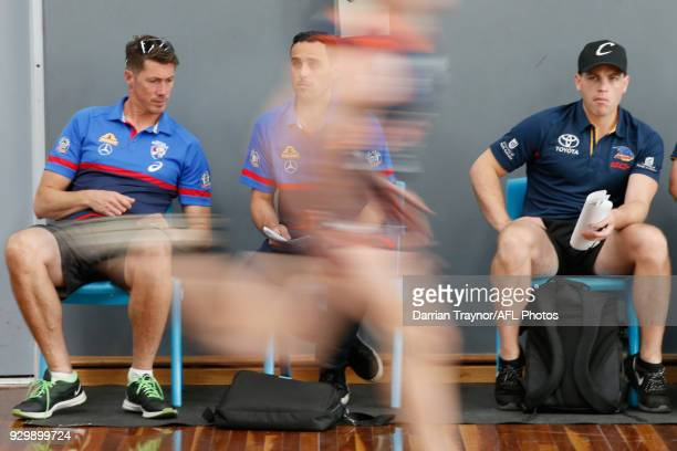 Participants perform in the sprint test as AFL recruiters look on during the TAC Cup Fitness Testing Day at Maribyrnong College on March 10 2018 in...