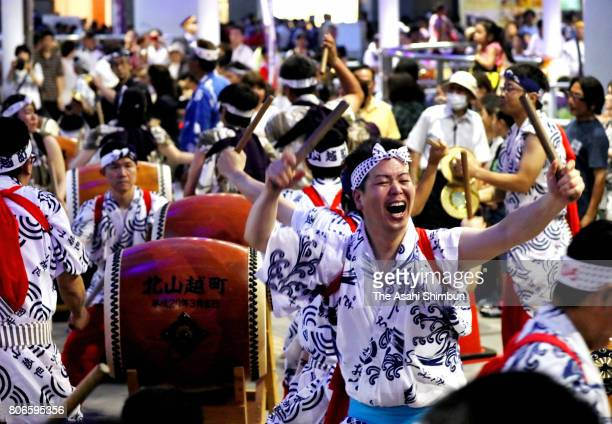 Participants perform Japanese drums during the 'UchizomeShiki' launching ceremony of the Kokura Gionon Daiko Festival at Kokura Station on July 1...