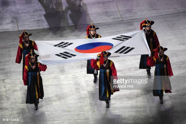 TOPSHOT Participants perform with South Korea's national flag during the opening ceremony of the Pyeongchang 2018 Winter Olympic Games at the...