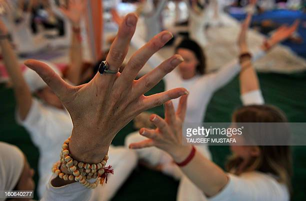 Participants perform yoga exercises during the international Yoga festival at the Parmarth Niketam Ashram in Rishikesh on March 4 2011Thirty six...