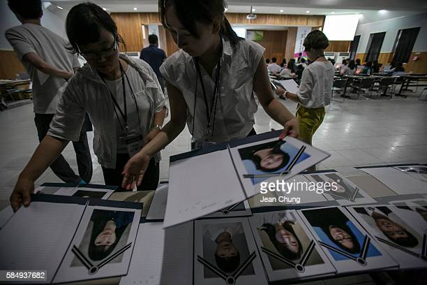 Participants pick up their own funeral photos during a Death Experience/Fake Funeral session held by Happy Dying led by Mr Kim Kiho who started this...