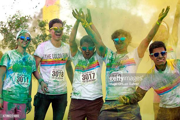 CONTENT] GUADALAJARA JALISCO MEXICO SEPTEMBER 29 Participants pictured in colored powder as they take part in the first edition of The Color Run in...