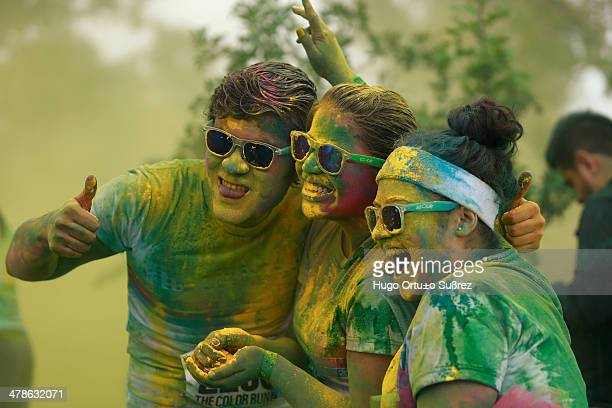 Participants pictured in colored powder as they take part in the first edition of The Color Run in Guadalajara City, Mexico. The Color Run, a...