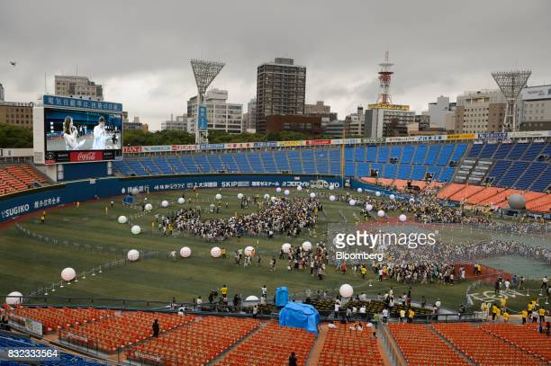 Participants play Nintendo Co's Pokemon Go augmentedreality game developed by Niantic Inc at Yokohama Stadium during a Pikachu Outbreak event...