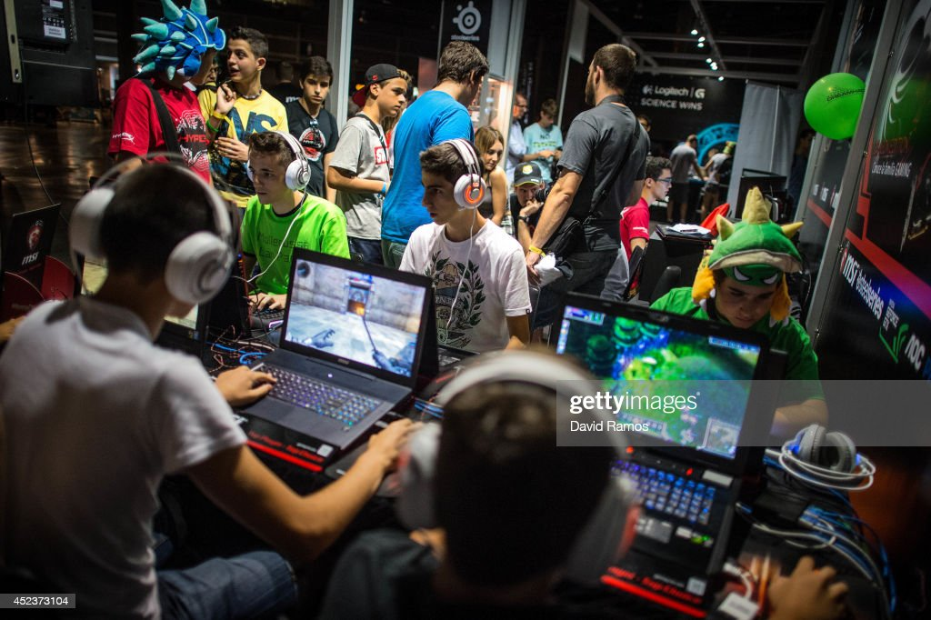Participants play on their computers during the DreamHack Valencia 2014 on July 18, 2014 in Valencia, Spain. Dreamhack Valencia is one of the European stops from the Dreamhack World Tour, the world's largest LAN party and computer festival. This year 3,000 devices will be connected to the Dreamhack Valencia network during 96 hours non-stop.