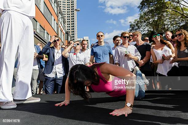 Participants play Twoup on Anzac Day at The Australian Hotel in the Rocks on April 25 2016 in Sydney Australia Twoup is a traditional Australian...