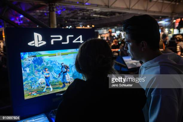 Participants play with the game console PS4 a video games at the 2018 DreamHack video gaming festival on January 27 2018 in Leipzig Germany The...