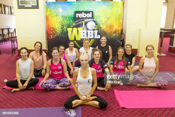 Participants pose after a cricket ball yoga session during a WBBL Opening Weekend Media Opportunity at Sydney Cricket Ground on December 4 2017 in...