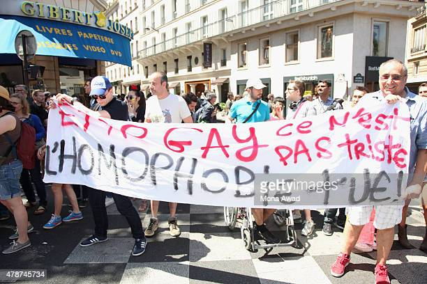 Participants pose during the annual Gay Pride Parade on June 27 2015 in Paris France Gay marriage was declared legal across the US in a historic...