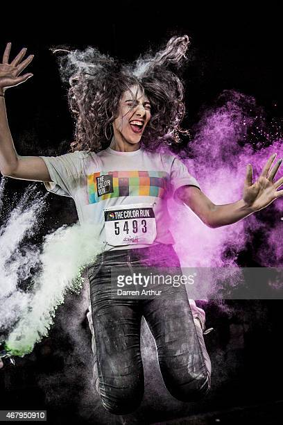 Participants pose during the Color Run on March 27 2015 in Abu Dhabi United Arab Emirates