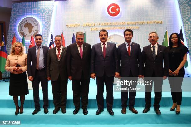 Participants pose for a family photo after the press conference of Turkey's Minister of Food Agriculture and Livestock Minister Faruk Celik and...