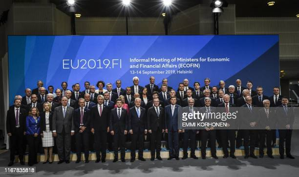 Participants pose for a family photo during the informal meeting of ministers for economic and financial affairs and Eurogroup in Helsinki Finland on...