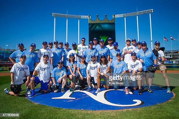 Participants pose for a photo before the celebrity softball game for the Big Slick Celebrity Weekend benefiting Children's Mercy Hospital Kansas City...