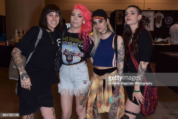 "Participants pose for a photo during day two of the ""19th Annual Northern Ink Xposure Tattoo Convention"" at the Metro Toronto Convention Centre on..."