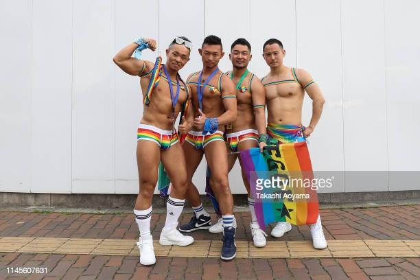 Participants pose for a photograph during the Tokyo Rainbow Pride Parade on April 28 2019 in Tokyo Japan Thousands from the Japanese LGBT community...