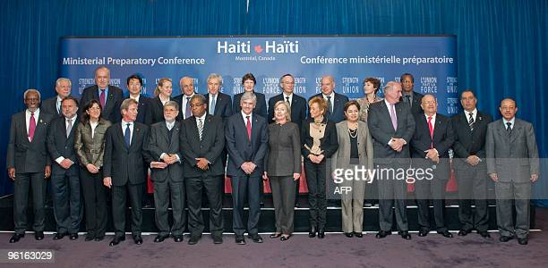 Participants pose for photographers at the end of the Haiti Ministerial preparatory conference at the International Civil Aviation Organization in...