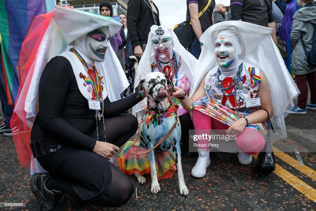 Participants pose with a dalmatian during the Glasgow Pride march on August 19, 2017 in Glasgow, Scotland. The largest festival of LGBTI celebration in Scotland has been held every year in Glasgow since 1996.