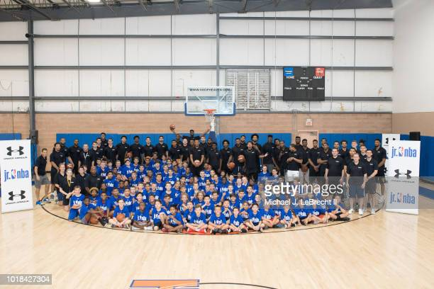 Participants pose with NBA Players for a group photo during the 2018 Jr NBA Rookie Clinic on August 15 2018 at Hoop Heaven in Whippany New Jersey...
