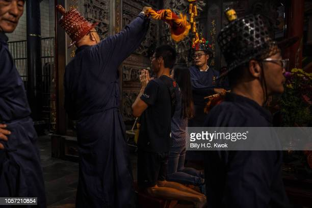 Participants pray at the temple during the Pingtung Wang Yeh BoatBurning Festival on November 3 2018 in Pingtung Taiwan The Wang Yeh Boat Burning...