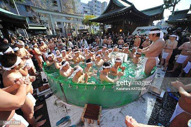 Participants pray in an ice pool at the TeppouzuInari Shrine in Tokyo Japan on January 9 2011 90 participants including some ladies take an ice bath...