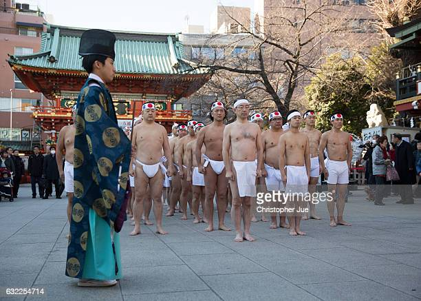 Participants pray prior to the start of the ice water winter purification ceremony on January 21 2017 in Tokyo Japan At Daikoku Matsuri festival...