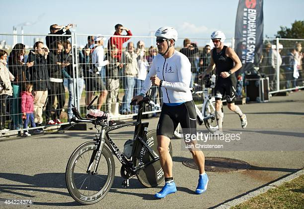 Participants prepare for cycling during KMD Ironman Copenhagen on August 24 2014 in Copenhagen Denmark