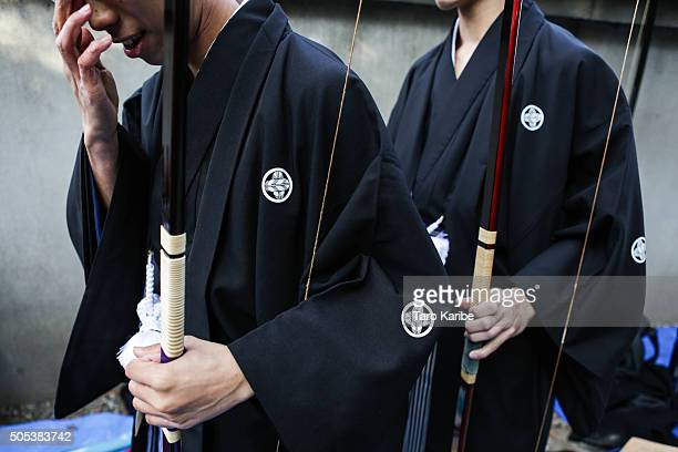 Participants prepare for their turn in an archery event for 20yearolds to celebrate their comingofage at Sanjusangendo Temple on January 17 2016 in...