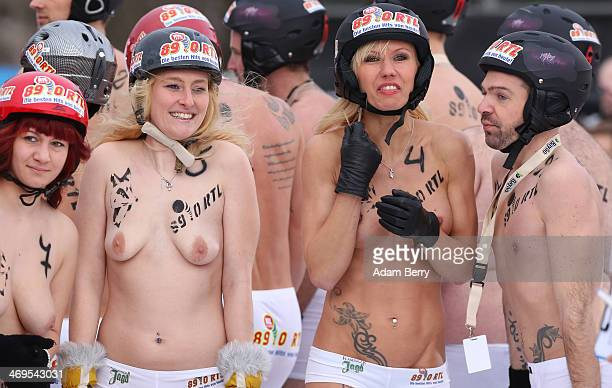 Participants prepare to compete in the 2014 occurrence of the annual naked innertube snowsledding competition on February 15 2014 in Hecklingen near...