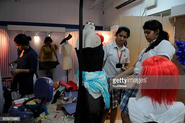 """Participants preparing their work during the """"Fashion Wall"""" event -an avant-garde approach of creative exploration throughout textile..."""