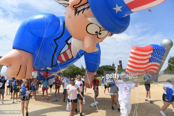 Participants pulls a balloon for the Independence Day parade in Washington DC on July 4 2019