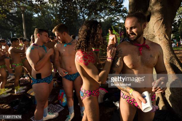 Participants put the finishing touches to their looks for the 2019 Sydney Gay Lesbian Mardi Gras Parade on March 02 2019 in Sydney Australia The...