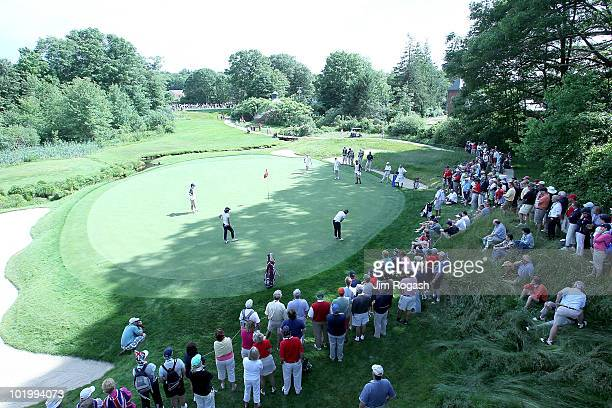 Participants putt on the seventh green in FourBalls competition during the 2010 Curtis Cup Match at the Essex Country Club on June 11 2010 in...