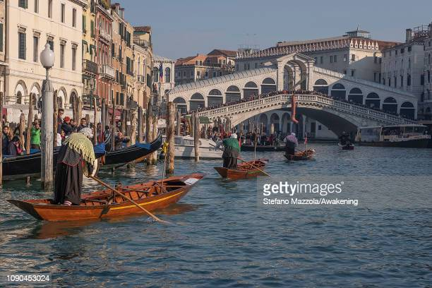 Participants race along the Grand Canal for the 'Befana' Regatta on January 6 2019 in Venice Italy In Italian folklore Befana is an old woman who...