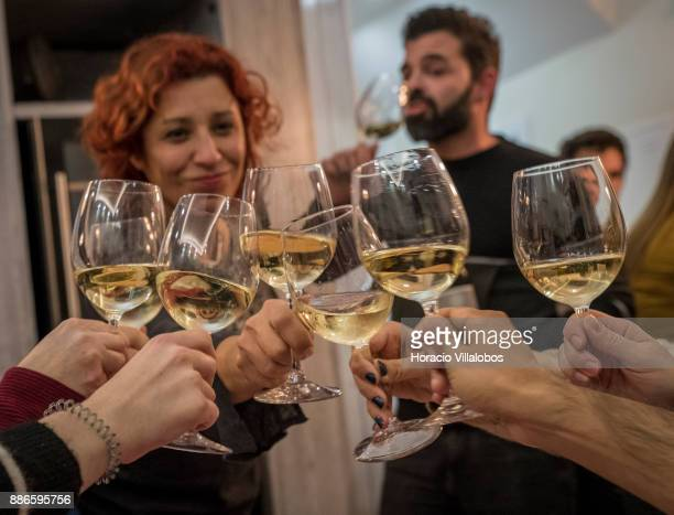 Participants raise their glasses in a toast at dinner in Restaurante No Tacho during Gastronomic FAM Tour on November 27 2017 in Coimbra Portugal...