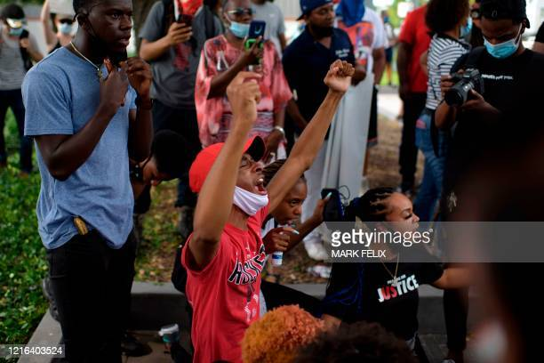 Participants react during a Justice for George Floyd event in Houston Texas on May 30 after George Floyd an unarmed black died while being arrested...