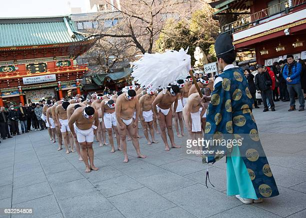 Participants receive a blessing from a Shinto priest prior to the start of the ice water winter purification ceremony on January 21 2017 in Tokyo...