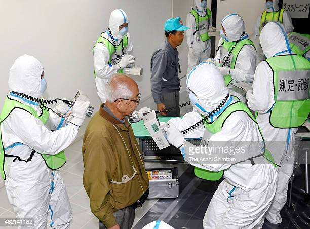 Participants receive radiation check during the threeprefecture joint emergency evacuation exercise at Itoshima Research Park on January 24 2015 in...