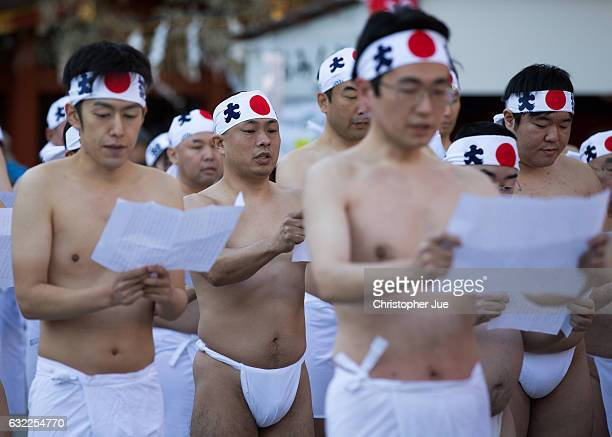 Participants recite prayers prior to the start of the ice water winter purification ceremony on January 21 2017 in Tokyo Japan At Daikoku Matsuri...