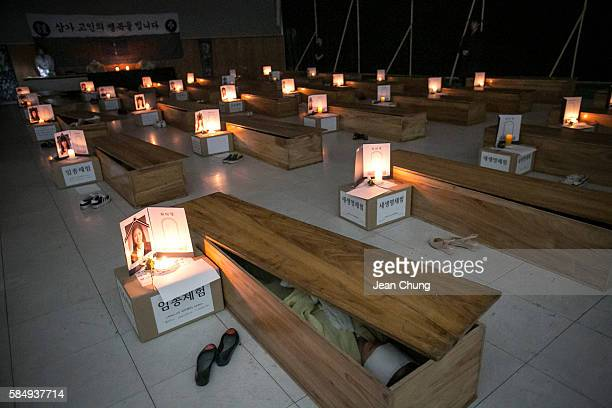 Participants reflect on their lives as they lie down inside coffins during a Death Experience/Fake Funeral session held by Happy Dying on August 1...