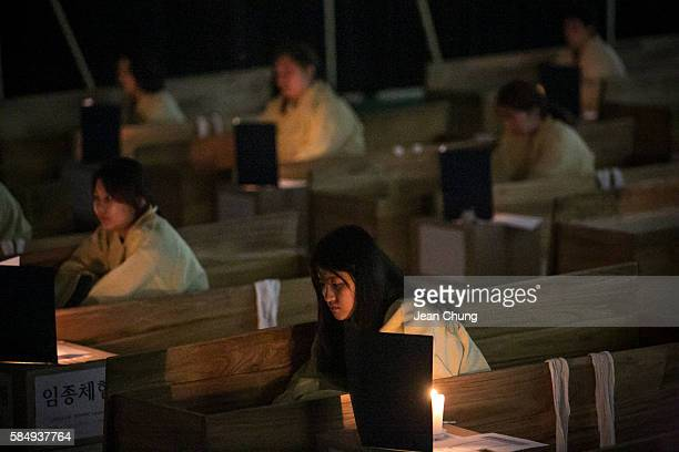 Participants reflect on their lives as they sit down inside coffins during a Death Experience/Fake Funeral session held by Happy Dying on August 1...