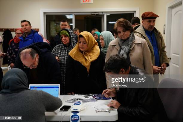 Participants register to vote during the firstinthenation Iowa caucus at the Islamic and Education Center Ezan mosque in Des Moines Iowa US on Monday...