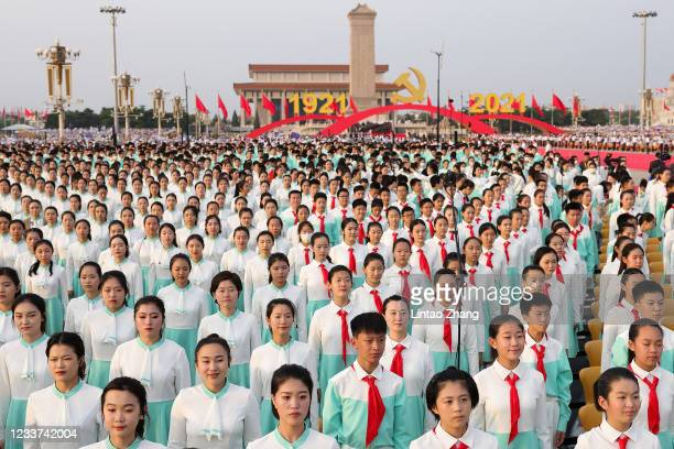 Participants rehearse in Tiananmen Square before a parade marking the 100th anniversary of the founding of the Chinese Communist Party on July 1,...