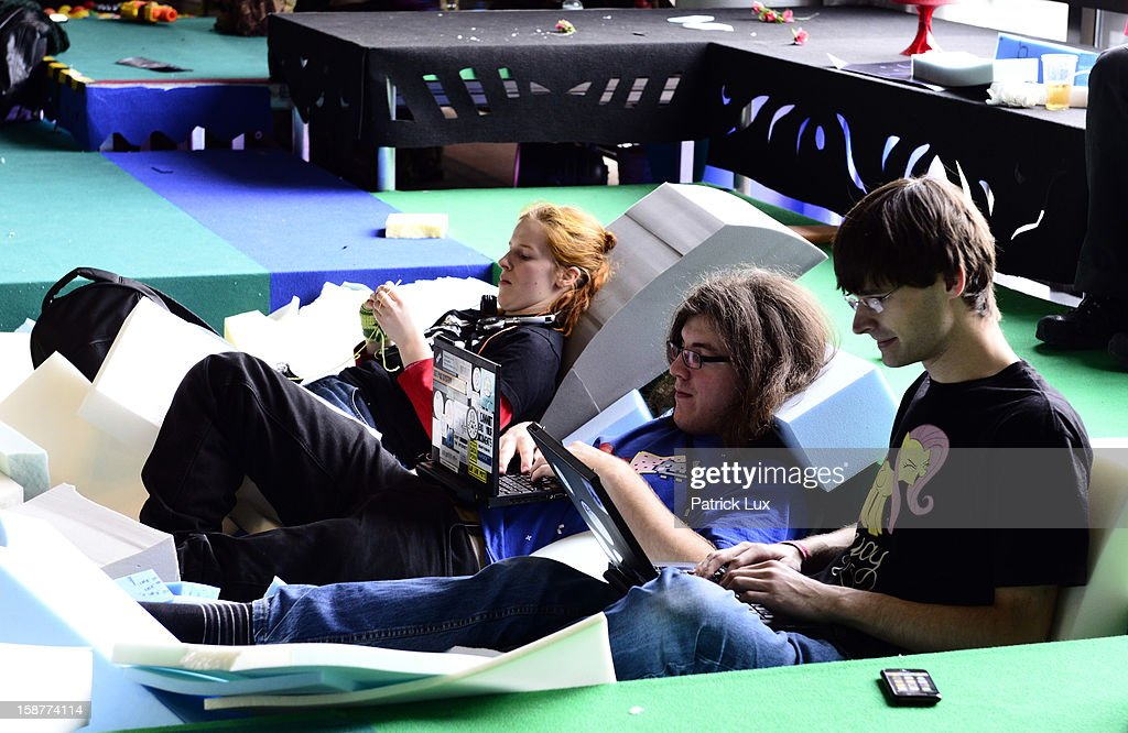 Participants rest in a foam pit at the annual Chaos Computer Club (CCC) computer hackers' congress, called 29C3, on December 28, 2012 in Hamburg, Germany. The 29th Chaos Communication Congress (29C3) attracts hundreds of participants worldwide annually to engage in workshops and lectures discussing the role of technology in society and its future.